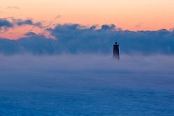 Whaleback Light in the pre-dawn fog. New Castle, New Hampshire.