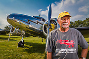 Joe Shepherd with his Lockheed 12A Electra Junior, which he flies often.  Created during AirVenture 2014.