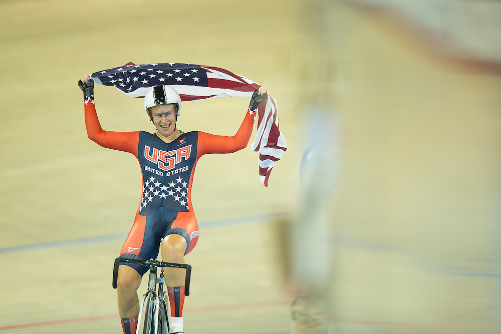 Sarah  Hammer of the United States celebrates her gold medal win in the women's cycling omnium at the 2015 Pan American Games in Toronto, Canada, July 19,  2015.  AFP PHOTO/GEOFF ROBINS