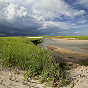 A squall races across Cape Cod Bay towards Paine's Creek Beach in Brewster