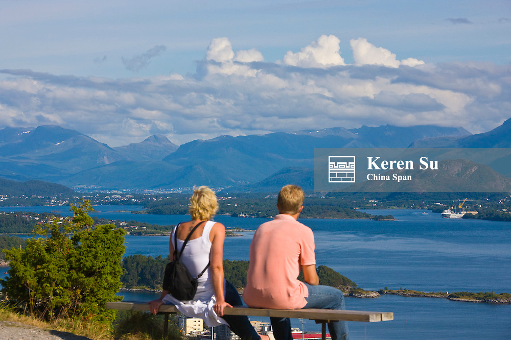 Tourists watch the fjord, Alesund, Norway