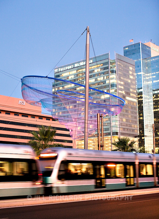Her Secret Is Patience, a 2009 art installation by Janet Echelman located at Civic Space Park in downtown Phoenix, AZ. Pictured with Phoenix light rail.<br />