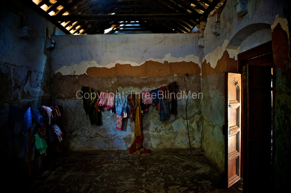 Clothes line in an unused room. An old Natcharam (square courtyard) house near Vaddukoddai.<br /> Jaffna homes. 2011