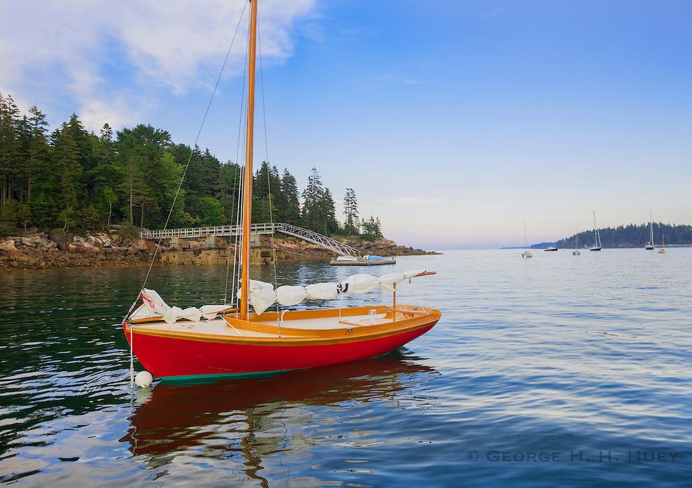 0902-1019  Classic wooden Herreshoff 12 1/2 class sailboat, [designed in 1914 by Nathanial Herreshoff].  Northeast Harbor, Maine.