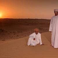 Beduins in Sand Dunes at sunrise, Wahabi Sands near Al Qabil, Sharqiya Region, Oman, Arabian Peninsula