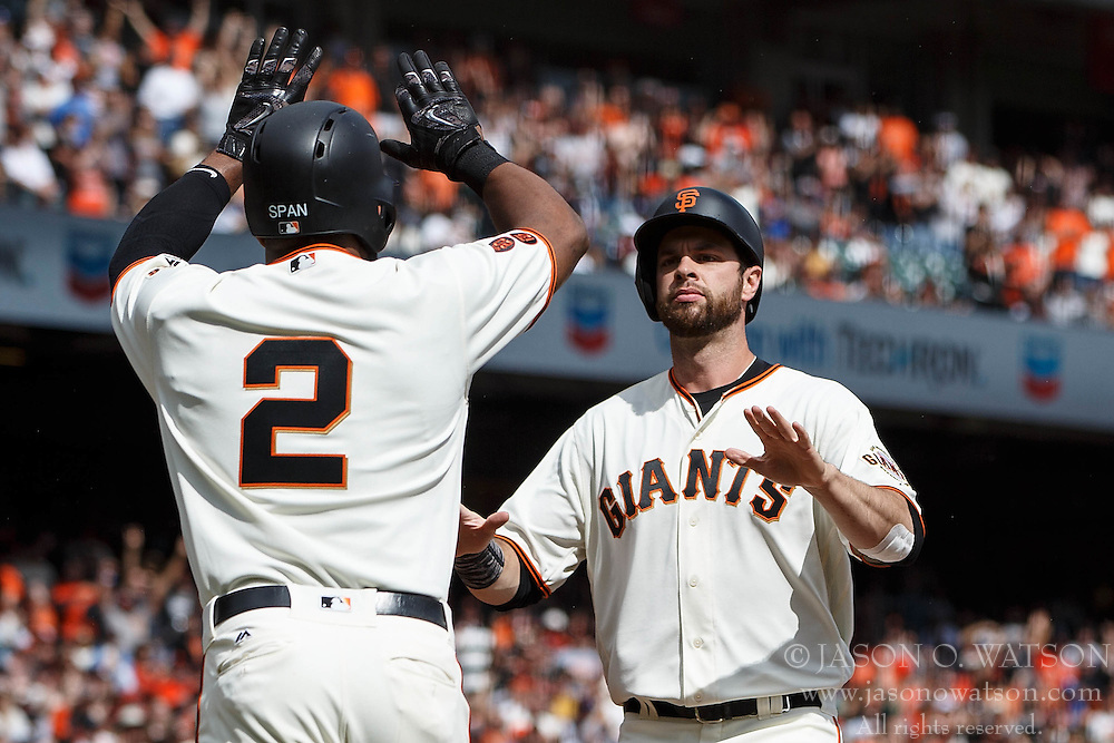 SAN FRANCISCO, CA - OCTOBER 02: Denard Span #2 of the San Francisco Giants and Brandon Belt #9 celebrate after scoring runs on a single hit by Buster Posey (not pictured) during the first inning against the Los Angeles Dodgers at AT&T Park on October 2, 2016 in San Francisco, California.  (Photo by Jason O. Watson/Getty Images) *** Local Caption *** Denard Span; Brandon Belt