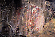 """Complex pictograph with petroglyohs, estimated to be 2000 - 3000 years old in the Columbia River Gorge National Scenic Area, Oregon. Native people who live in the area refer to the creators of the rock art in the Columbia River area as the """"River People"""". Much of the original rock art in the area has been flooded by hydro projects or vandalized, but there remain some prinstine examples in out of the way areas."""