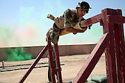 17th Iraqi Division soldiers clibs over an obstacle during a training exercise August 30, 2010 at the Joint Security Station (JSS) Deason in Mahmoudiyah, Iraq.