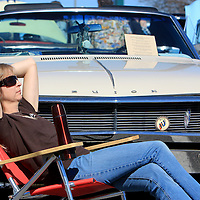 Lisa Schnitzler of Wilmington sits in front of her 1968 Buick Skylark Convertable during the Lower Cape Fear Chapter of the Antique Automobile Club of America's 42nd annual Antique Automobile show Saturday March 8, 2014 at Independence Mall in Wilmington. (Jason A. Frizzelle)