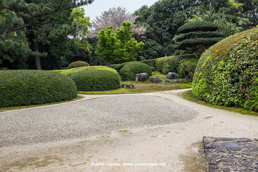 Jiko-in was founded in 1663 by Sekishu Katagiri, a feudal lord of the area who mastered the way of Zen Buddhism and tea ceremony.  He believed that tea ceremony was part of his meditation regime, and so constructed a tea ceremony room and garden for this purpose.  The garden is well known for its elaborate shrubbery - and also includes a larger view of the Yamato plain and hills, contrasted with the temple, tea room, trees, stones, shrubs and grass.  Jiko-in is also very unique in that it is a rare exception that visitors can wander around the shrubs and dry rock garden.  Included in the cost of entry is matcha tea and sweets.