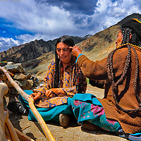 A Drokpan woman getting her hair made in preparation of a local festival.