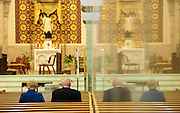 A couple sits inside St. Francis Xavier Cathedral in Green Bay. (Photo by Sam Lucero)