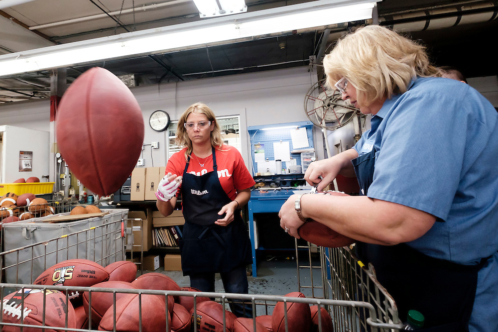 Nikki Allen, left, and Pam Clark inspect official balls for the NFL Super Bowl 50 football game at the Wilson Sporting Goods Co. in Ada, Ohio, Tuesday, Jan. 26, 2016. The Denver Broncos will play the Carolina Panthers in the Super Bowl on Feb. 7, in Santa Clara, CA. (AP Photo/Rick Osentoski)