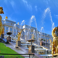 Grand Cascade Statues and Fountains at Peterhof Palace in Saint Petersburg, Russia<br /> In 1705, Peter the Great began designing Petrodvorets on the Baltic Sea near Saint Petersburg, Russia. He wanted his summer palace to resemble Versailles in France. Empress Elizabeth, Catherine the Great and Nicholas I expanded the opulent estate called Peterhof Palace. The Grand Cascade is spectacular. It has 64 fountains and 200 bronze, Romanesque statues. Equally impressive is the Grand Palace and surrounding gardens.