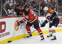 November 8, 2007; Newark, NJ, USA;  New Jersey Devils left wing Patrik Elias (26) and Philadelphia Flyers center Jim Dowd (34) battle behind the Flyers net during the second period at the Prudential Center in Newark, NJ.