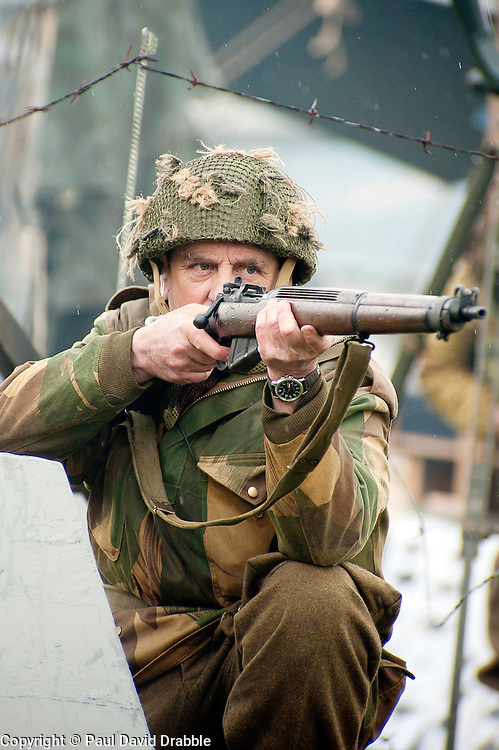 Renecator portraying a British Paratrooper from the 6th Airborne Division takes aim with his Lee Enfield rifle during a battle reenactment at Fort Paull Monday<br /> 7  May 2012<br /> Image &copy; Paul David Drabble