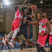 Delaware 87ers Guard RUSS SMITH (0) challenges Salt Lake City Stars Center HENRY SIMS (41) in the paint in the second half of an NBA D-league regular season game between the Delaware 87ers and the Salt Lake City Stars (Utah Jazz) Friday, March 17, 2017 at The Bob Carpenter Sports Convocation Center in Newark, DEL