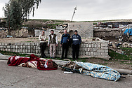 Iraq, west Mosul: Civilians stand nearby the dead bodies of two relatives (wife and husband).<br /> The couple was killed weeks earlier but because of the intense fighting they were buried in a temporary location and only now the relatives managed to exhume the bodies to take them in a cemetery in the other side of the city. Alessio Romenzi