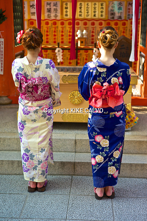 Japanese woman wearing traditional kimonos entering the ¨Love Shrine¨ at the Kiyomizu Temple.
