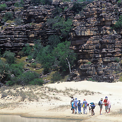 Travelers exploring shore at Tranqulity Bay, Kimberley, AUSTRALIA