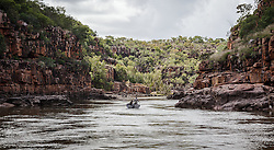 Tourists enjoy the spectacular cliffs of the Sale River on the Kimberley coast in the wet season.