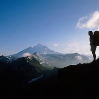 Mt. Baker, North Cascades, WA, USA.10,778 ft / 3285 m..Backpacker in Mt. Baker Wilderness Area..Ptarmigan Ridge trail..2000 Brett Baunton