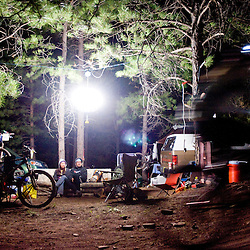 Brian and Carrie Culligan relax trailside on Saturday evening. Their camping setup, which included a couch, chandelier and a talking Dr. Evil cutout, kept racers entertained throughout the weekend.