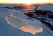Alaska. Girdwood. Alyeska Resort in the Chugach Mountains, a world class ski resort nestled next to the Chugach National Forest. View from above the GLacier Bowl looking towards Turnagain Arm at Sunset.