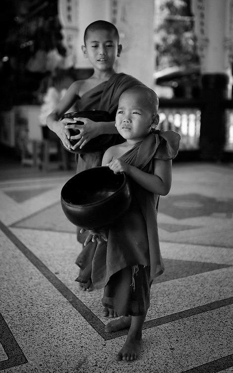 Novices collecting alms, Myanmar.