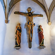 Christian crucifix, INRJ. Appenzell's Roman Catholic St. Maurice (or Mauritius) parish church was built 1560–84 at Adlerplatz, the heart of Appenzell village, in Switzerland, Europe. Most of the notable buildings in Appenzell were built in the 1500s. Appenzell Innerrhoden is Switzerland's most traditional and smallest-population canton (second smallest by area).