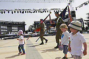 Soldiers visited by young children while practice for the main ceremony of Israeli Independence day on mount Herzl. on May 05, 2011. Photo by Oren Nahshon.