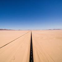 Africa, Namibia, Aerial view of highway passing through Namib Desert near abandoned town of Garub