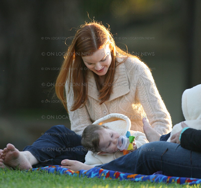 LOS ANGELES, CALIFORNIA - Friday December 14th 2007. EXCLUSIVE: Marcia Cross plays with her twin girls Eden and Savannah in the park. The twins are are now ten months old. Marcia Cross met up with her nanny who had been looking after the two girls in the park while Marcia did a Starbucks run. Photograph: David Buchan/ On location News. Sales: Eric Ford 1/818-613-3955 info@OnLocationNews.com
