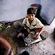 A child labour working in a factory after his school hours. Image © Balaji Maheshwar/Falcon Photo Agency