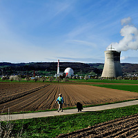 WOman walking her dog in teh countryside close to Leibstadt nuclear power station, which stands close to the German border.<br /> The Swiss are due to vote shortly in a referendum whether to quit nuclear power, which via its five reactors, on four sites, provide almost 40% of the country's power