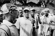 Young men who work as laborers who work for the government are paid $1.75 per day, Port-au-Prince, Haiti. A can of rice in the city costs .70 cents which means that even with this job they cannot feed and house themselves or their families. Unemployment in Haiti is estimated at 70%.....