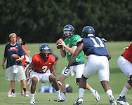 Ole Miss quarterback Bo Wallace (14) looks to pass at football practice in Oxford, Miss. on Sunday, August 4, 2013.