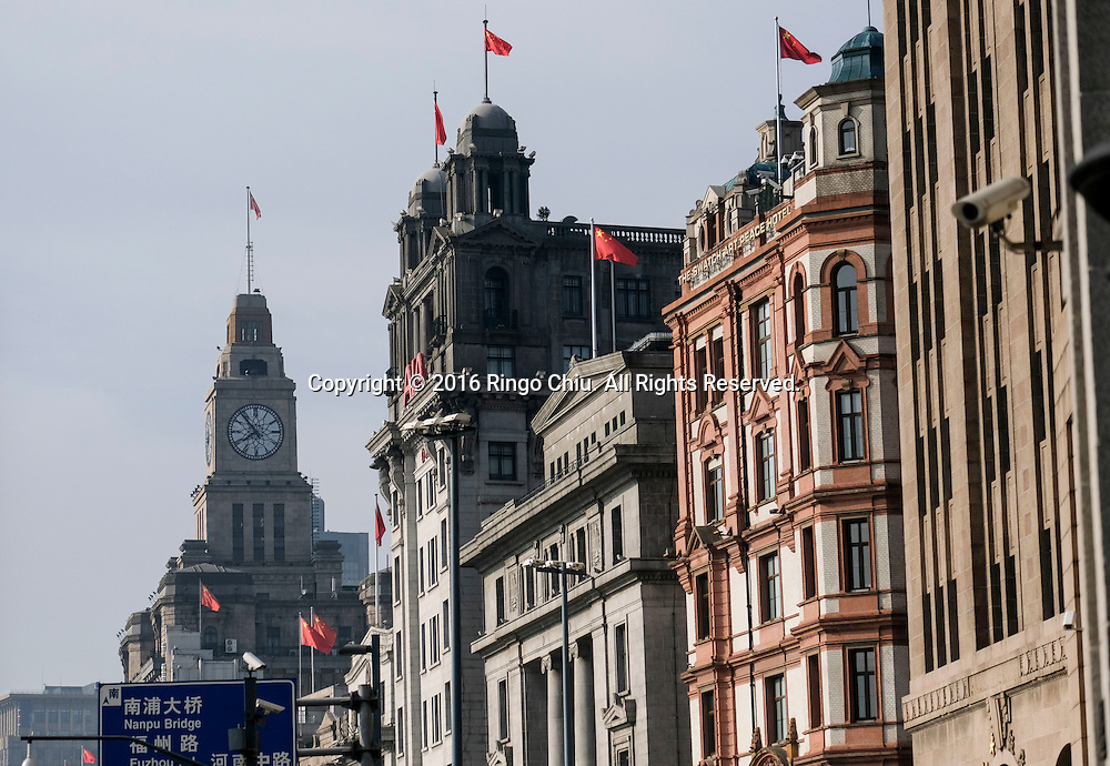 Western-style architectures along the Bund in Shanghai, China. Shanghai is the most populous city in China and the most populous city proper in the world. It is one of the four direct-controlled municipalities of China, with a population of more than 24 million as of 2014. It is a global financial centre, and a transport hub with the world's busiest container port. Located in the Yangtze River Delta in East China, Shanghai sits on the south edge of the mouth of the Yangtze in the middle portion of the Chinese coast. The municipality borders the provinces of Jiangsu and Zhejiang to the north, south and west, and is bounded to the east by the East China Sea. A major administrative, shipping, and trading town, Shanghai grew in importance in the 19th century due to trade and recognition of its favourable port location and economic potential. The city was one of five forced open to foreign trade following the British victory over China in the First Opium War while the subsequent 1842 Treaty of Nanking and 1844 Treaty of Whampoa allowed the establishment of the Shanghai International Settlement and the French Concession. The city then flourished as a center of commerce between China and other parts of the world (predominantly Western countries), and became the primary financial hub of the Asia-Pacific region in the 1930s. However, with the Communist Party takeover of the mainland in 1949, trade was limited to socialist countries, and the city's global influence declined. In the 1990s, the economic reforms introduced by Deng Xiaoping resulted in an intense re-development of the city, aiding the return of finance and foreign investment to the city. Shanghai has been described as the &quot;showpiece&quot; of the booming economy of mainland China; renowned for its Lujiazui skyline, museums and historic buildings, such as those along The Bund, the City God Temple and the Yu Garden.(Photo by Ringo Chiu/PHOTOFORMULA.com)<br /> <br /> Usage Notes: This content is intended for edi