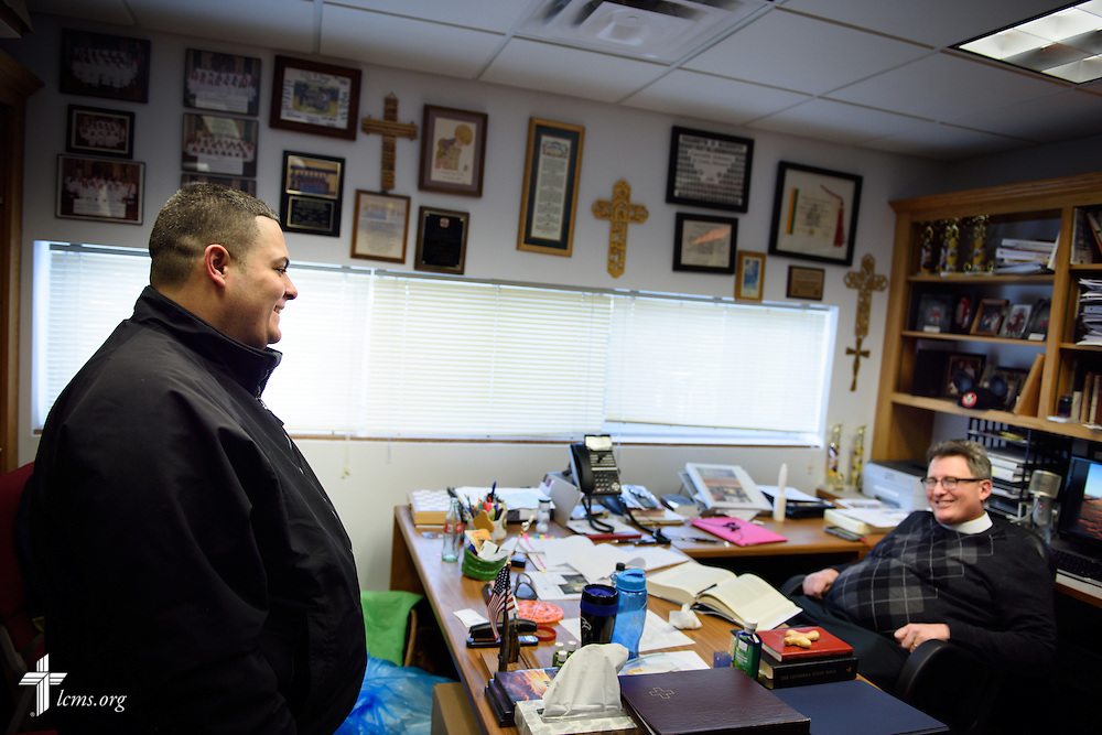 Vicar David Blas, missionary-at-large at LCMS Sheboygan County Hispanic Outreach and St John's Lutheran Church of Plymouth, Wis., chats with his supervisor, the Rev. Nathan Meador, senior pastor of St. John's., in his office  on Thursday, Jan. 28, 2016, in Plymouth. LCMS Communications/Erik M. Lunsford