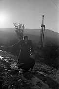 02/02/1963<br /> 02/02/1963<br /> 02 February 1963<br /> Ambassador Oil drilling site, Glengevlin, Dowra, Co. Cavan. Sixty-five year old Mrs. Susan McGovern and pet &quot;Fuddy&quot; make the daily one mile trip for water even as the drill searches for oil in her &quot;backyard&quot; o land recently owned by Mrs McGovern. (original caption)
