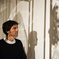 London, UK - 2 September 2014: Artist Xavier Mascaró looks at the shadow of one of his works 'Masks'. Xavier Mascaró's first UK solo exhibition will run from 3 September until 5 October at Saatchi Gallery.