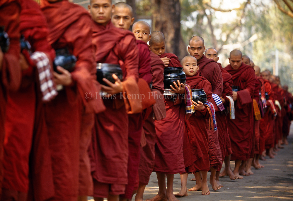 Monks in Myanmar lining up to receive alms