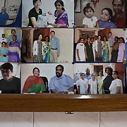 The board of photographs of previous western clients at the Akanksha Infertility and IVF Clinic in Anand, Gujarat, India. The centre has become the most popular clinic for outsourcing pregnancies by western couples.