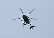 A police helicopter hovering overhead.