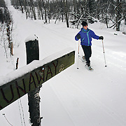 Jon Tandler (cq) of Cherry Hills Village snowshoes on one of the many trails that run through the hills surrounding the Home Ranch in Clark, Co. on Friday February 2, 2007. Tandler was there for the third time and was out enjoying the outdoors with his wife and two kids. The 1,500 acre ranch is a high-end dude ranch by summer and a cross country skiing and snowshoeing paradise in the winter. The Home Ranch also welcomes guests with world-class dining at the all-inclusive ranch near Steamboat Springs. The ranch has been open since 1980 and rates in the winter range from $420/night for a room in the lodge to $525/night for a cabin..(MARC PISCOTTY/ © 2007)