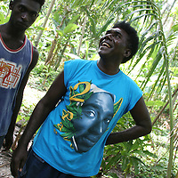 """Islanders in the """"garden"""", one wearing a Tupac Shakur t-shirt, on Han Island, Carteret Atoll, Papua New Guinea, on Sunday, Dec. 10, 2006."""