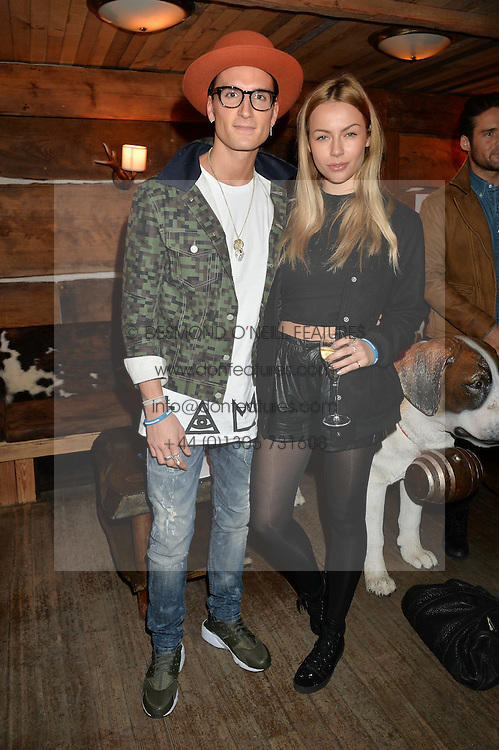 OLIVER PROUDLOCK and EMMA LOU CONNOLLY at Skiing With Heroes Junior Committee Awareness Party held at Bodo's Schloss, 2A Kensington High Street, London on 6th November 2014.
