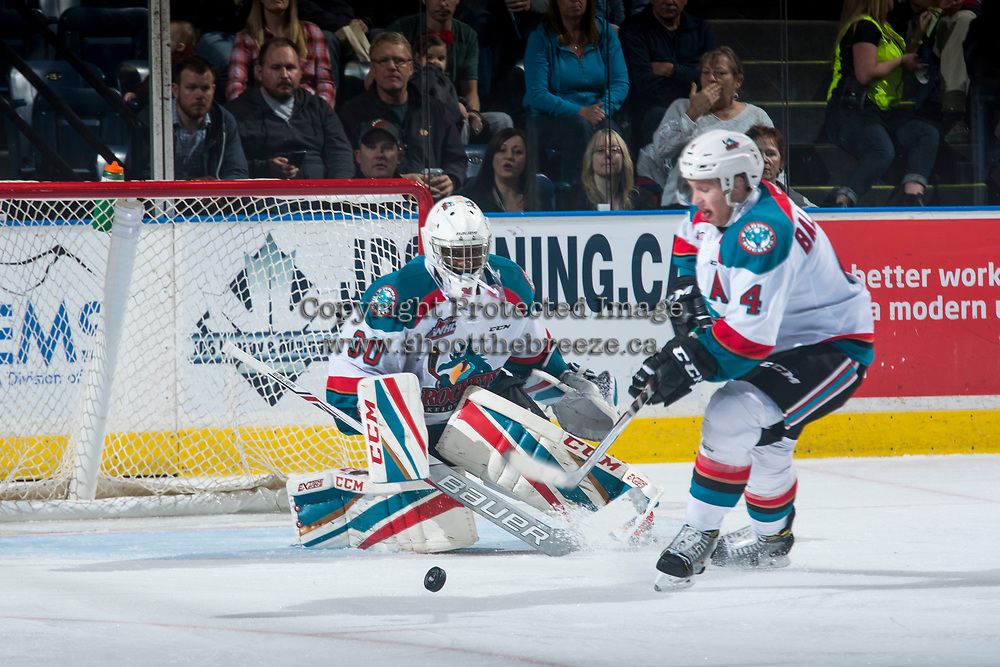 KELOWNA, CANADA - MARCH 25: Gordie Ballhorn #4 clears the puck from in front of Michael Herringer #30 of the Kelowna Rockets against the Kamloops Blazers during second period on March 25, 2017 at Prospera Place in Kelowna, British Columbia, Canada.  (Photo by Marissa Baecker/Shoot the Breeze)  *** Local Caption ***