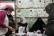 Egyptian women check their voter registration numbers before casting their votes in the first truly democratic Presidential election in Egypt's history May 23, 2012 in Cairo Egypt. Coming 15 months after the revolution that toppled the regime of former President Hosni Mubarak, the election will not only decide the leader of the country, but also set the tone and decide the course by which the country moves forward in democracy and reform.  (Photo by Scott Nelson)
