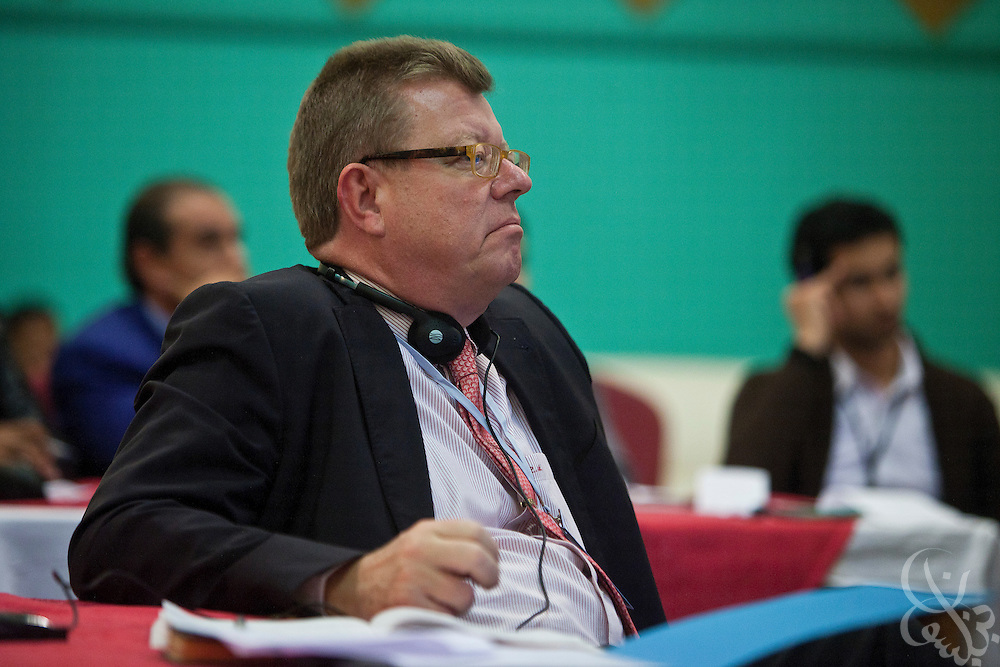Dr. Ronald Meinardus, Regional Director of the Friedrich Naumann Foundation for Liberty (FNF) listens to political speakers at an FNF sponsored conference on Liberalism and civic state building in Benghazi, Libya December 17, 2011.  (Photo by Scott Nelson, for Der Spiegel)